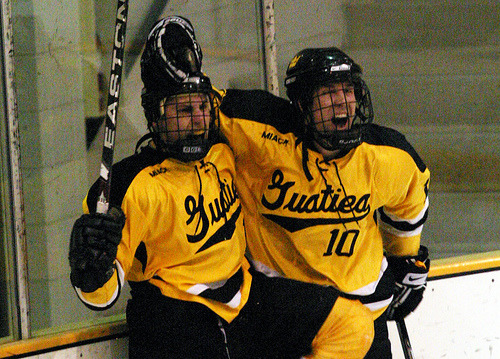 Brad Wieck and Ross Ring-Jarvi celebrate after Wieck scored the eventual game-winning goal.