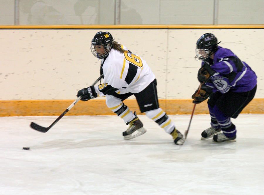 Whitney Schaff keeps the puck from a Tommie defender in the Gusties 1-0 win over St. Thomas earlier this season.