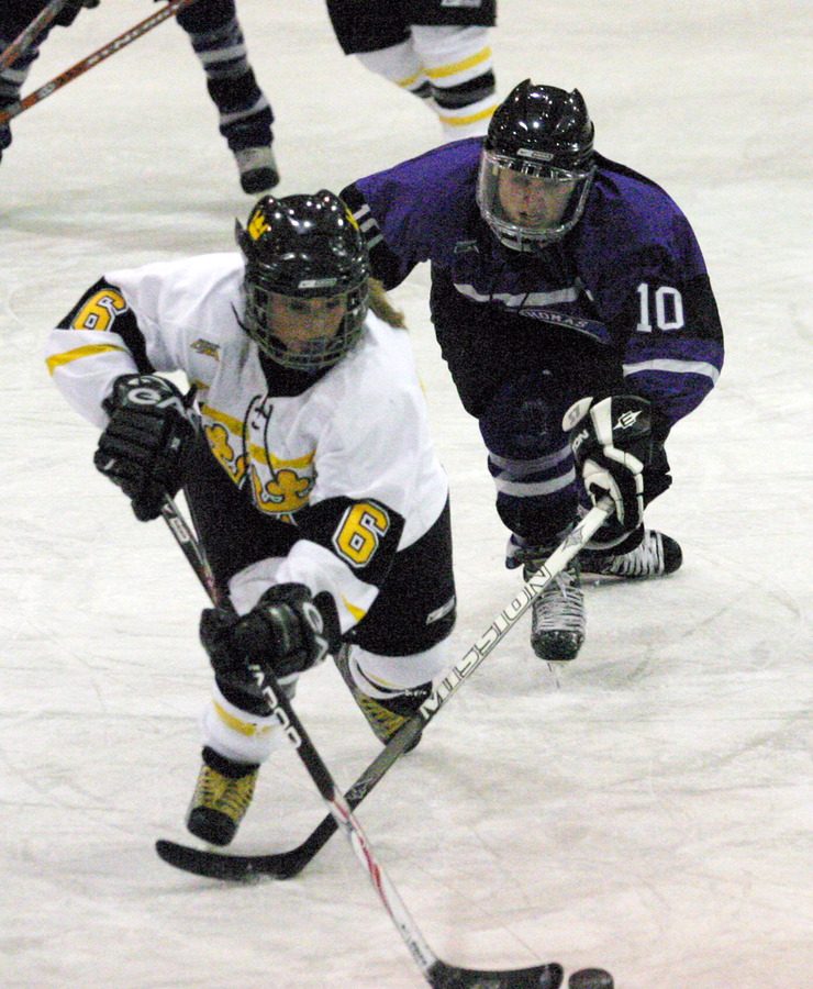 Whitney Schaff works to skate past a St. Thomas defender.
