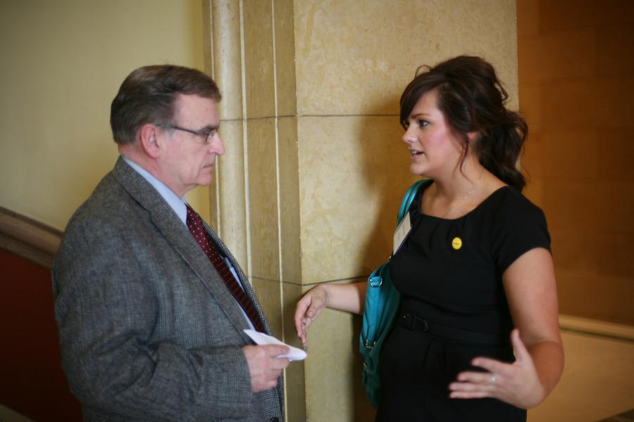 Gustavus senior Kacy Wothe talks to her hometown legislator Bud Nornes.