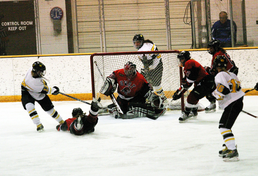 Jessie Doig fires a point blank shot at Cassie Campbell who comes up with the save.