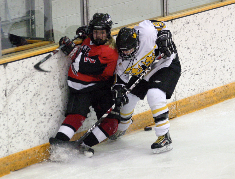 Alyssa Gaulrapp battles on the boards with Bailey Vikstrom of UW-River Falls.