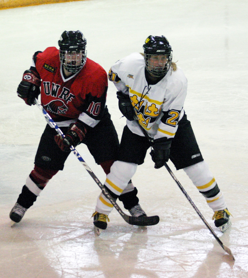 Allie Schwab battles for position with Amanda Ryder of UW-River Falls.
