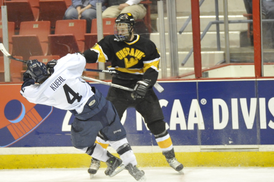 Eric Bigham checks a UW-Stout skater. (Photo Courtesy: Pat Hendrick)