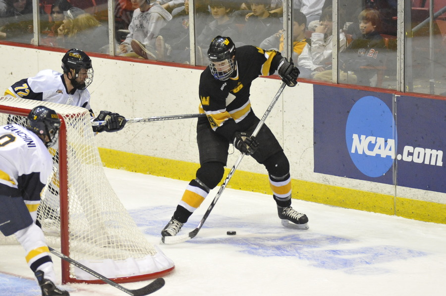 Eric Bigham plays the puck behind the net. (Photo Courtesy: Pat Hendrick)