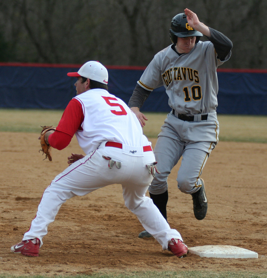 Mike DesLauriers hustles back to first base before the tag.  (Saint Mary's Sports Information)