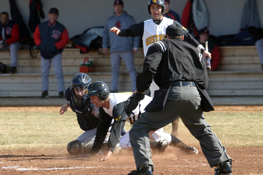 Andrew Woitas beats the throw in a play at the plate.