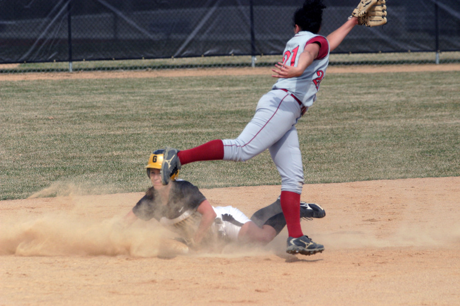 Emily Klein steals second base with a head first slide.
