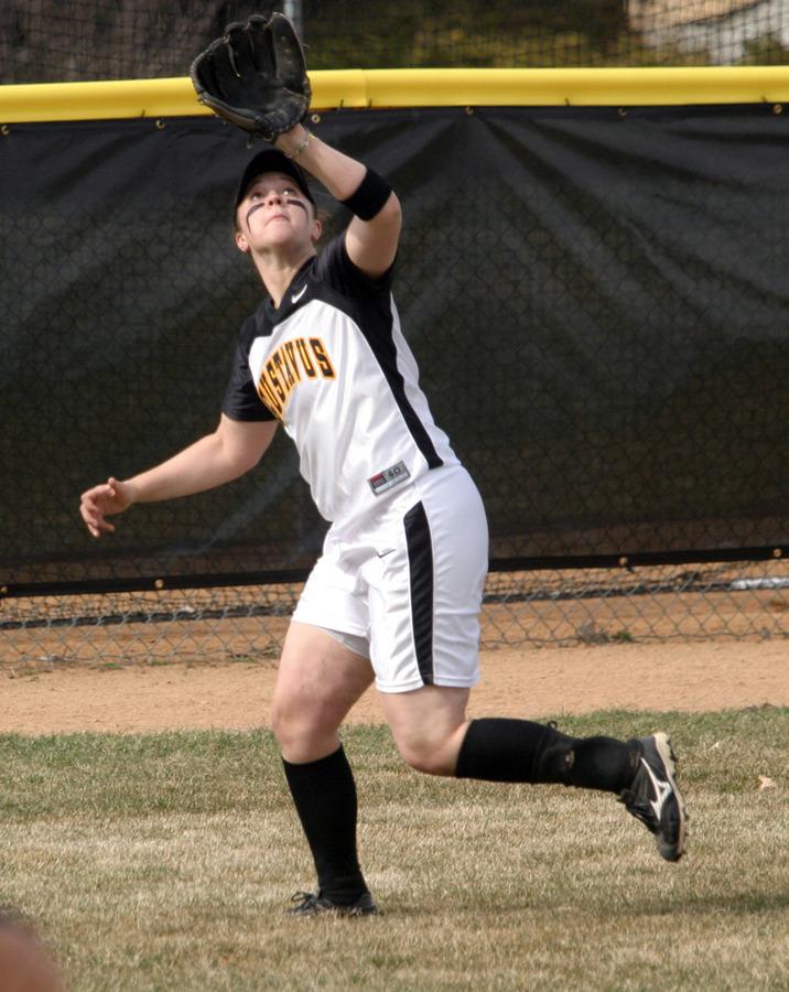 Kirsten Prunty tracks down a fly ball in left field.