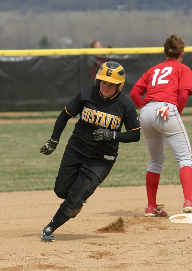 Jenny Ewert rounds second and heads for third in the second inning of game two.