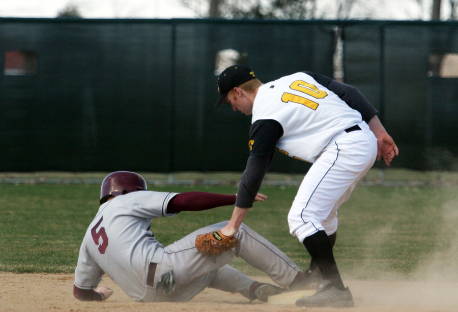Mike DesLauriers applies the tag at second base.