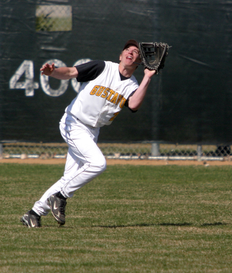 Cody Sukalski battles the wind to catch a fly ball.