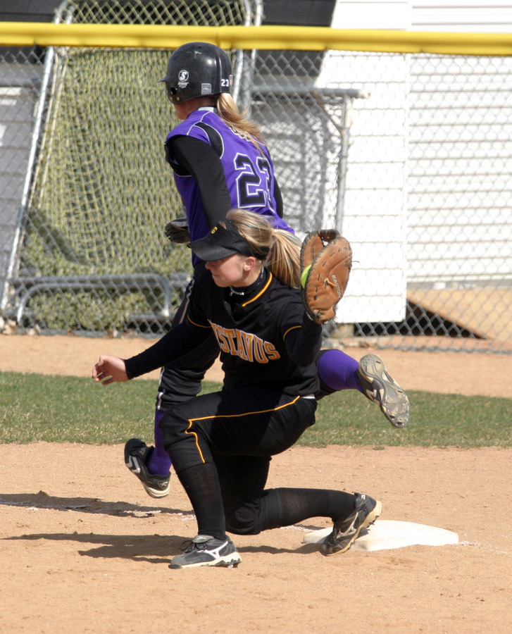 Emily Wendorff stretches to narrowly get a St. Thomas runner out at first base.