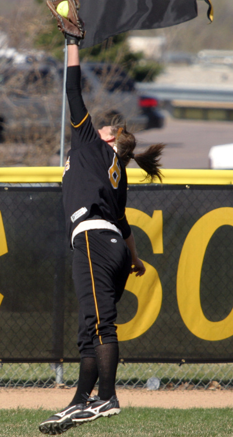Emily Klein leaps to make a spectacular catch that saved two runs in the second inning of game one.