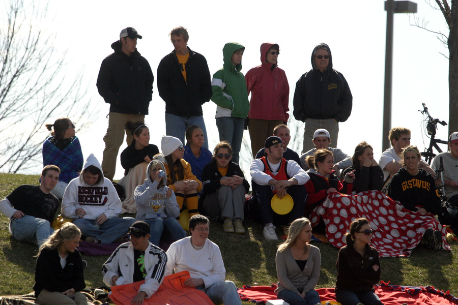 A crowd of nearly 400 gathered on the hillside to watch the Gusties and Tommies battle for first place in the MIAC.