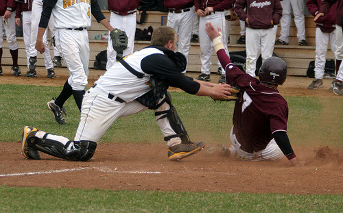 Augsburg's Craig Henry slides under the tag by Matt Morgan.