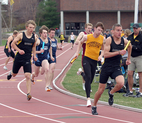 Carson Smith hands off the baton to Justin Lund in the 4x800 relay.