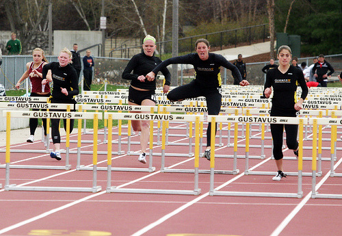 Kaelene Lundstrum and Aryn Bell push towards the finish line in the 110-meter hurdles.
