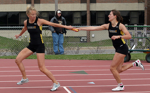 Two Gusties pass the baton in the 4x400 meter relay.