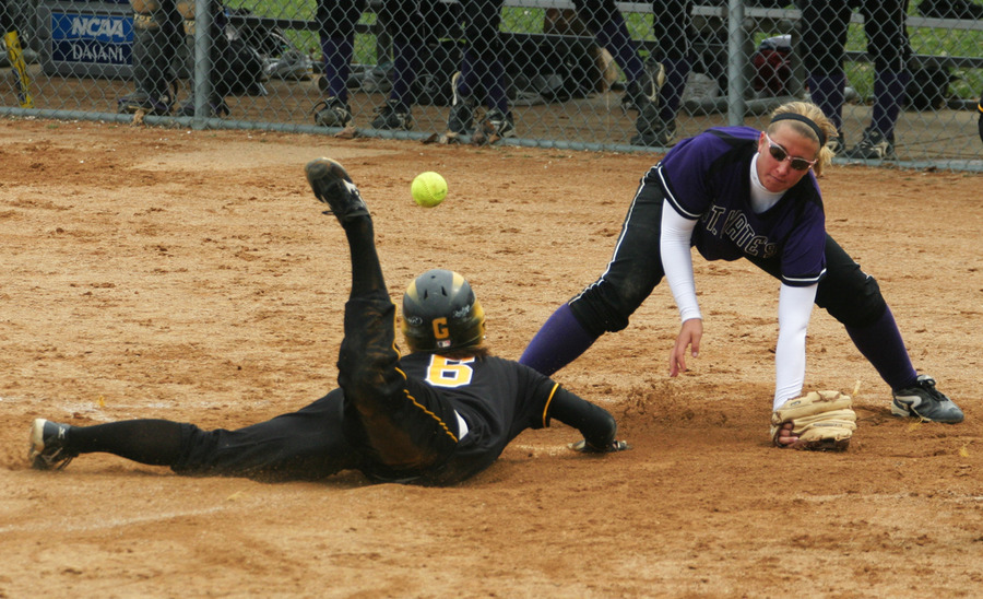 Emily Klein slides safely in to home.