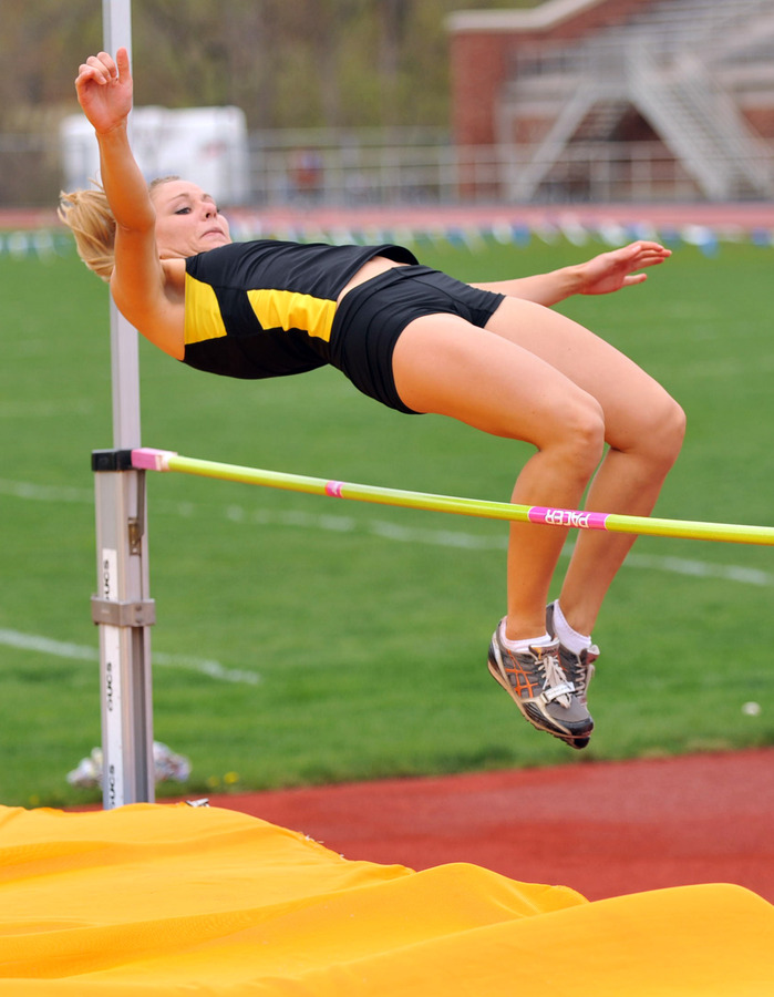 Janey Helland clears the high jump bar. (Carleton Sports Information)