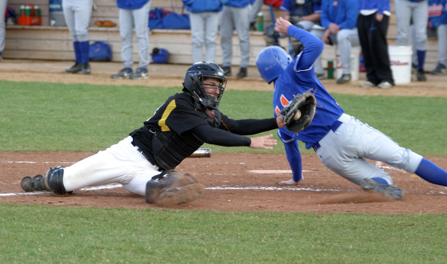 Matt Morgan tries to apply the tag on the runner at home.
