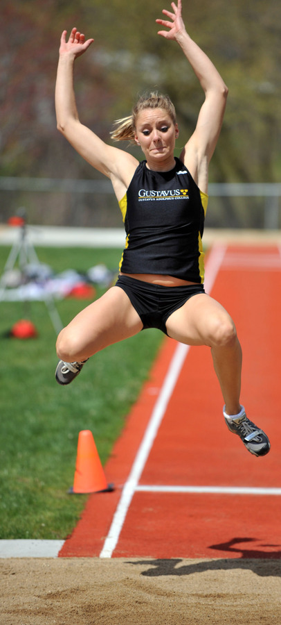 Janey Helland finished first in the long jump at 17-4 1/4. (Photo by Dave Pape)