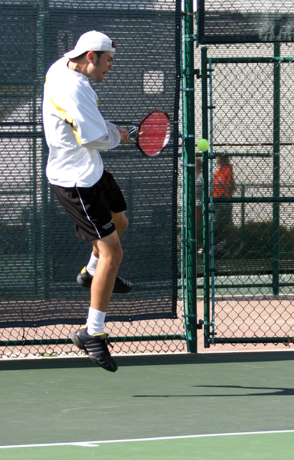 Nick Hansen rips a backhand against St. Thomas.