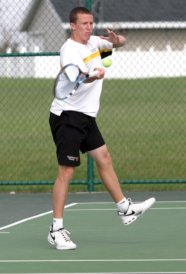 Pat Clark lines up a forehand against St. Olaf.