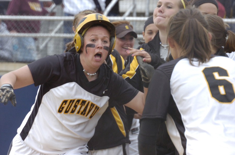 Kirsten Prunty celebrates after hitting a three-run home run in the first inning.