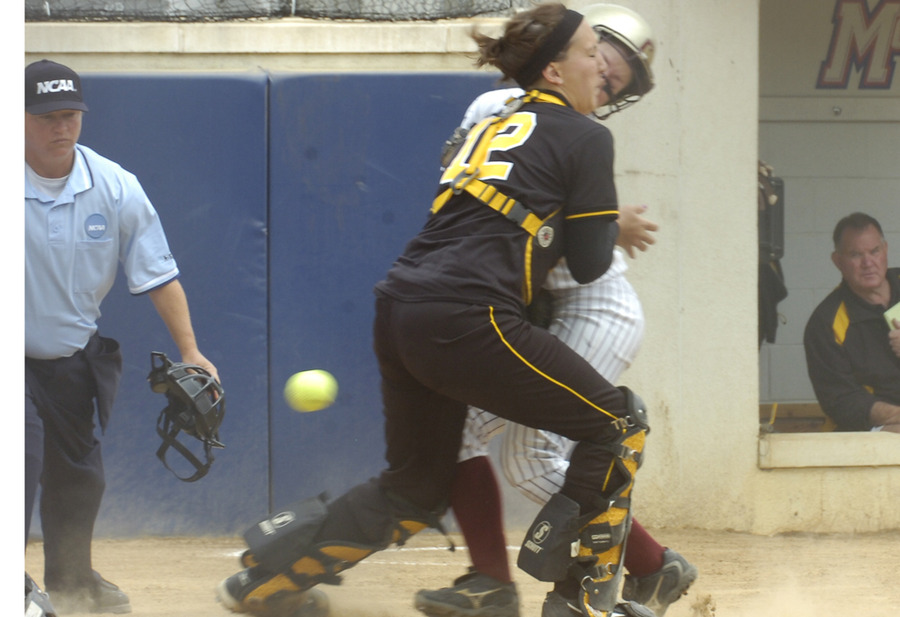 Catcher Dani Cattrysse tries unsuccessfully to tag a Coe player out at the plate in the first inning.
