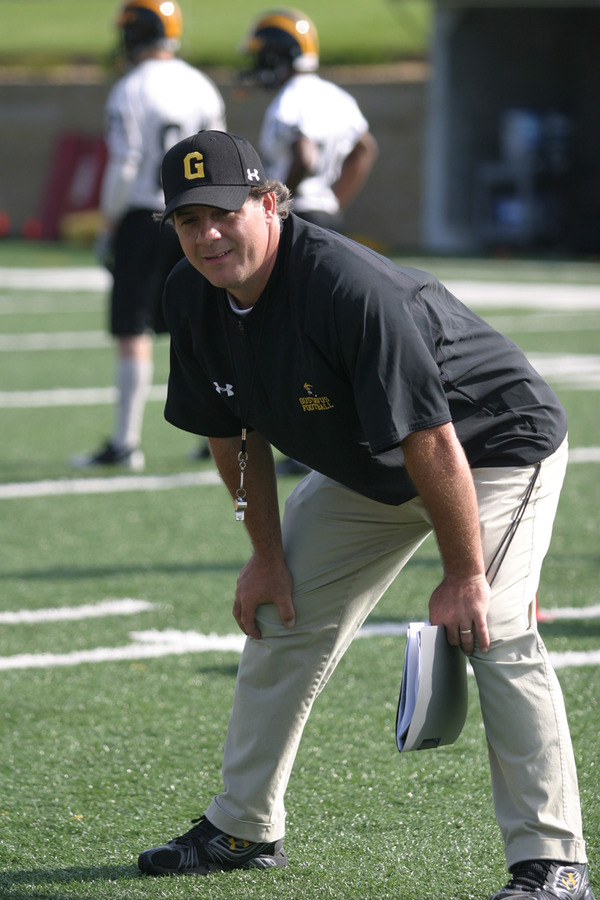 Coach Haugen intently watches the offense run a drill.