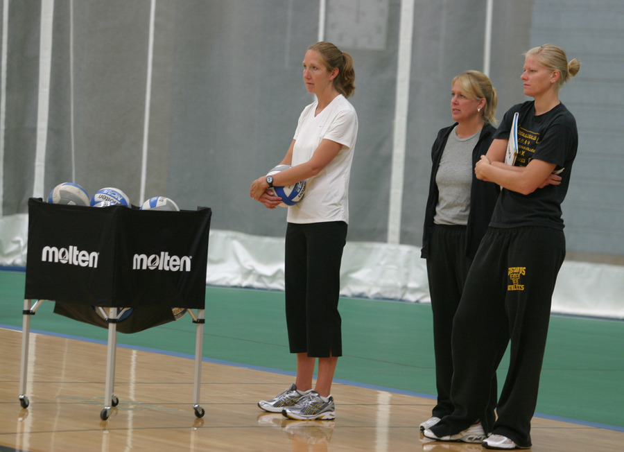 Head Coach Kari Eckheart (left) watching practice with assistants Mickey Haller (center) and Jen Thelemann (right).