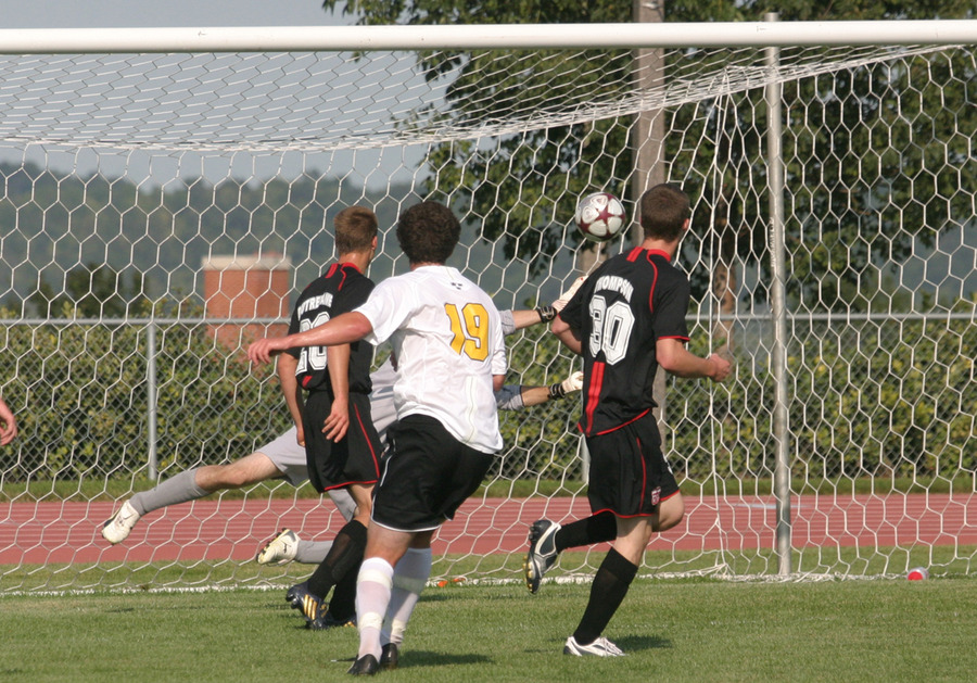 Senior midfielder Fraser Horton drives a ball past Bethany's outstretched goalkeeper and into the back of the net.