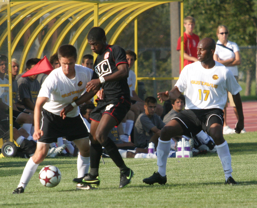 Ben Ikeda (left) and Abdul Suleyman (right) converge on Bethany's Evans Tackie-Yarboi in the midfield.