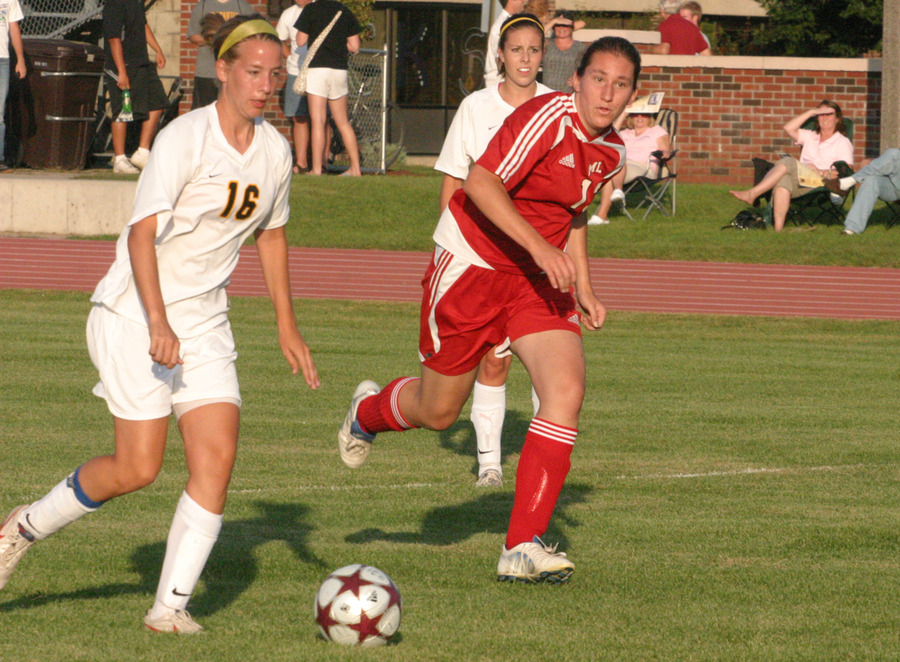 Karen Maus, who registered two assists in the game, dribbles the ball up the field.