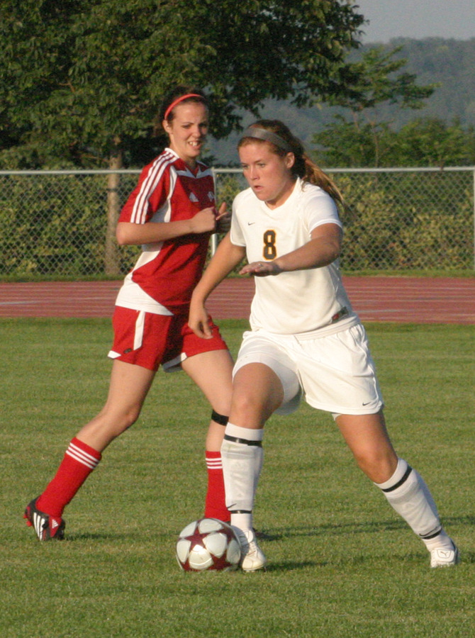 Junior Bekah Jorgenson works the ball through the midfield.