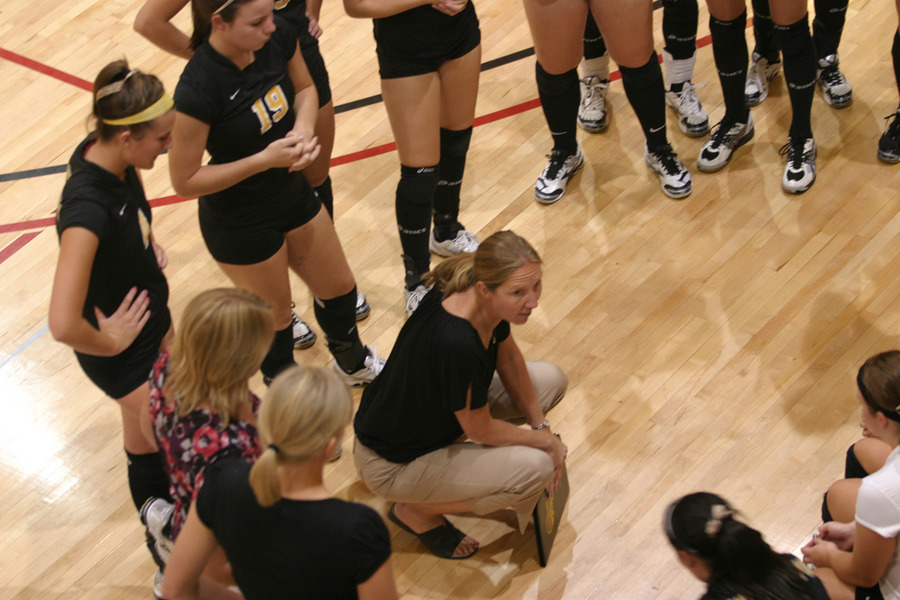 Coach Kari Eckheart discusses strategy during a timeout.