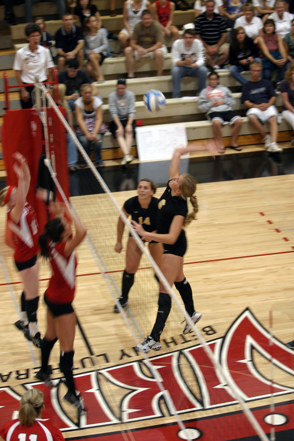 Meghan Gehring goes up for a kill.