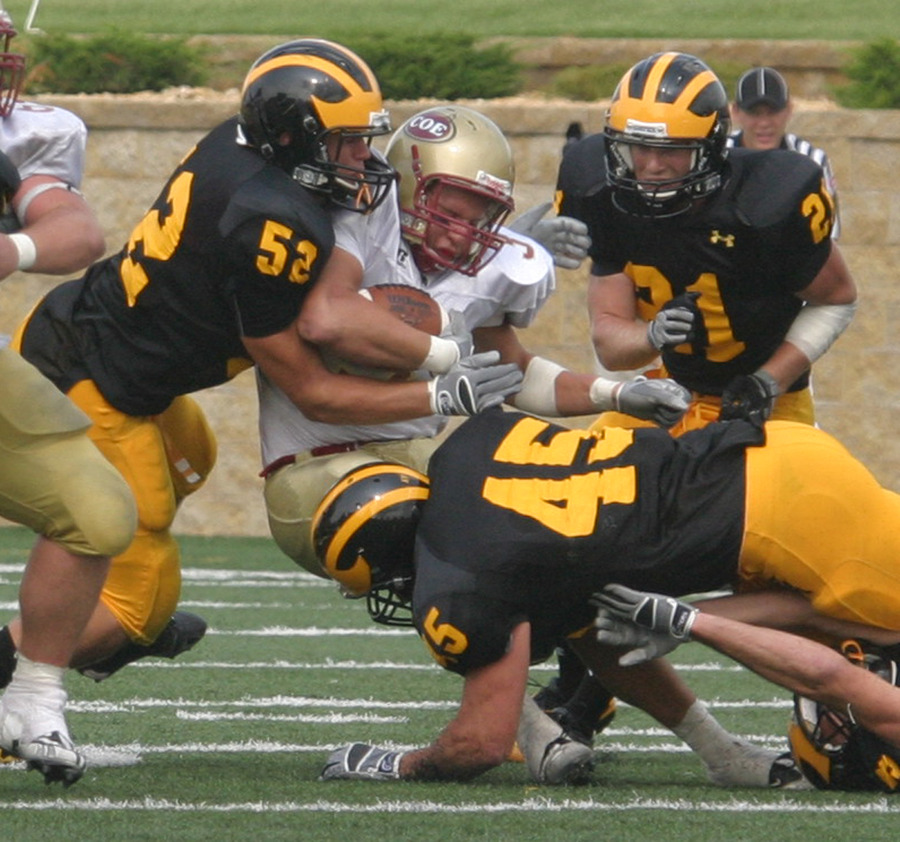 The Gustie defense wraps up a Kohawk running back.