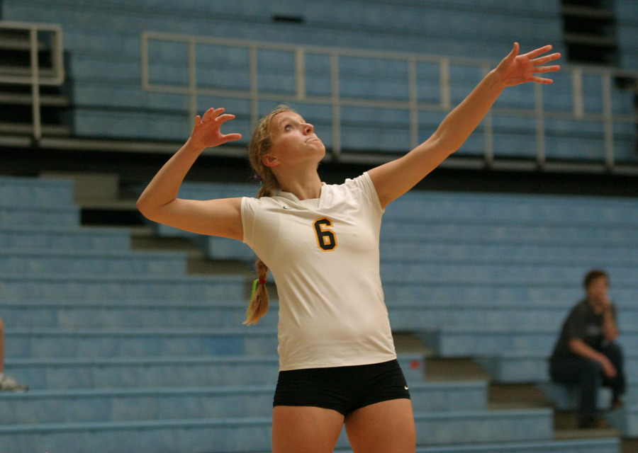 Meghan Gehring serving for Gustavus.
