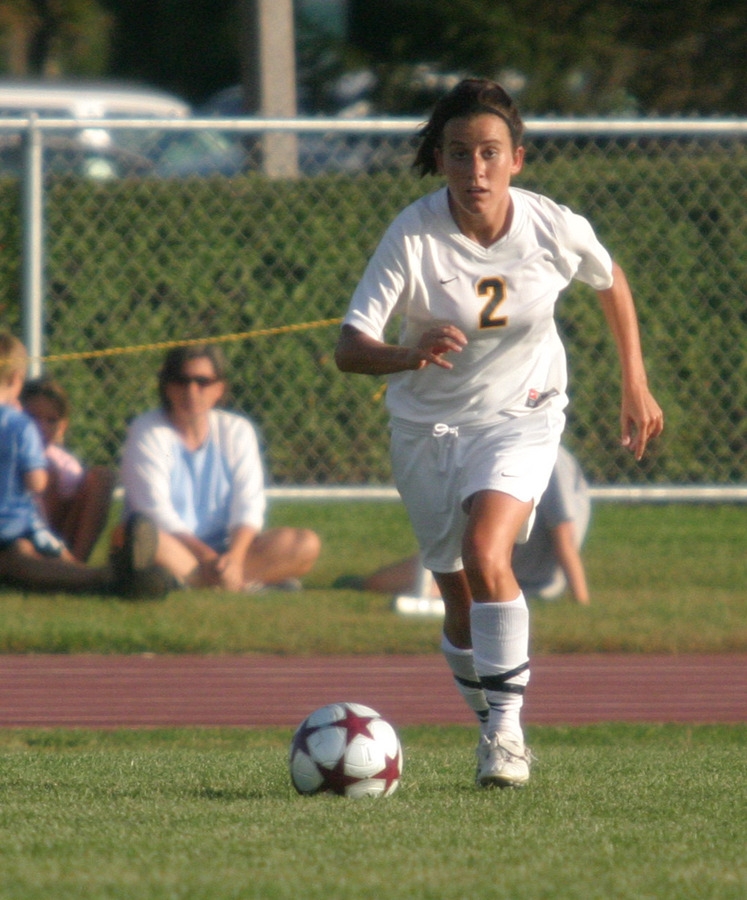 Kirsten Thulien advancing the ball against Carleton.