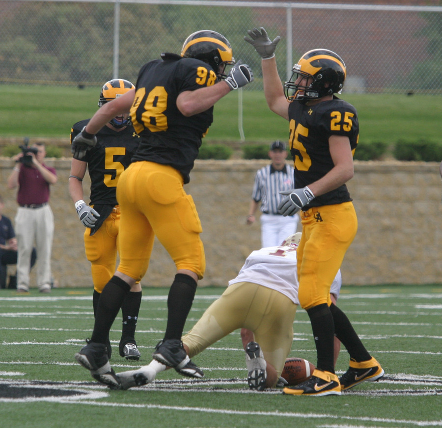Dustin Kammerer and Christian Vanek celebrate a sack against Coe last week.
