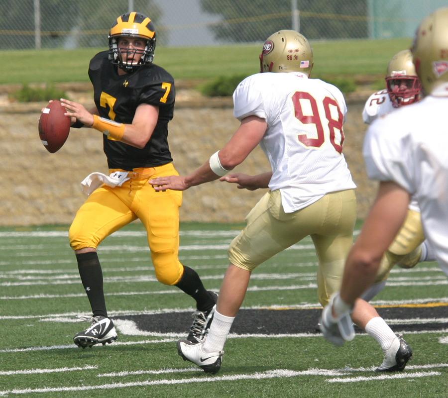 Jordan Becker threw for a career high 348 yards against Coe.