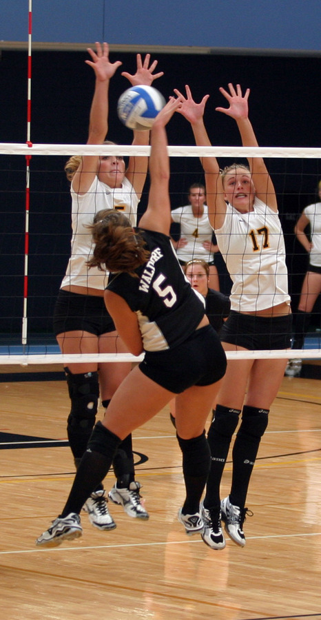 Abby Roff (5) and Emily Phillips (17) block a Waldorf attack.