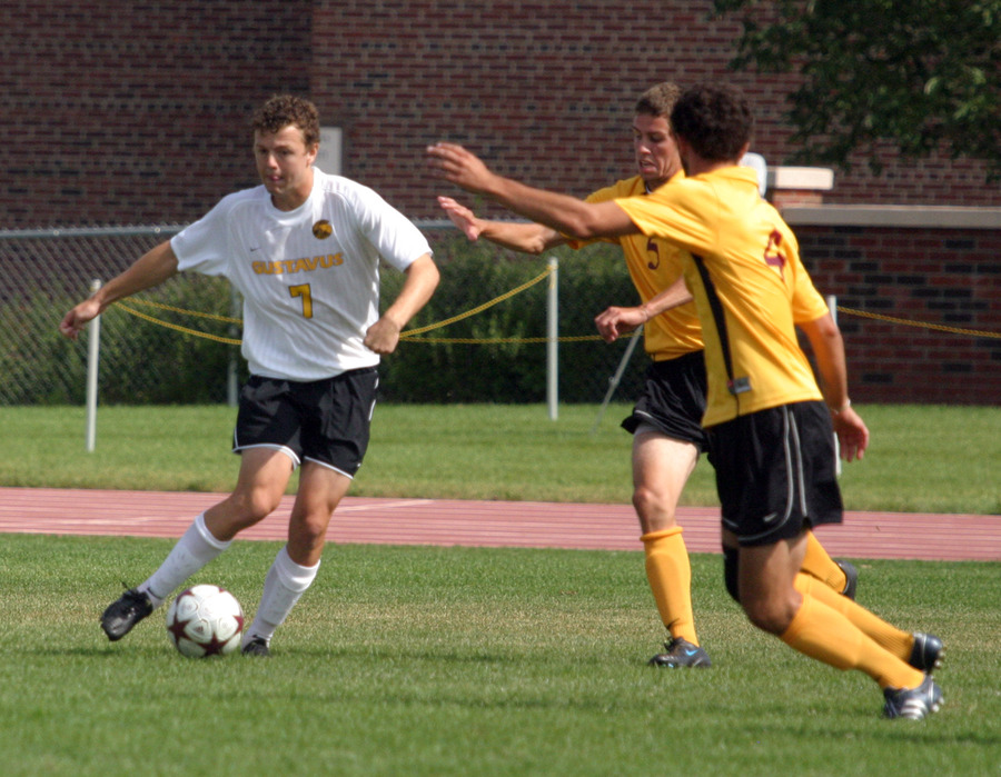 Max Malmquist dribbles his way past two Cobber defenders.
