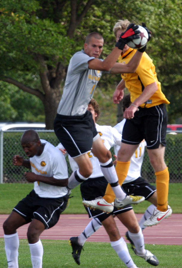 Luke Strom goes up high for a save for Gustavus.