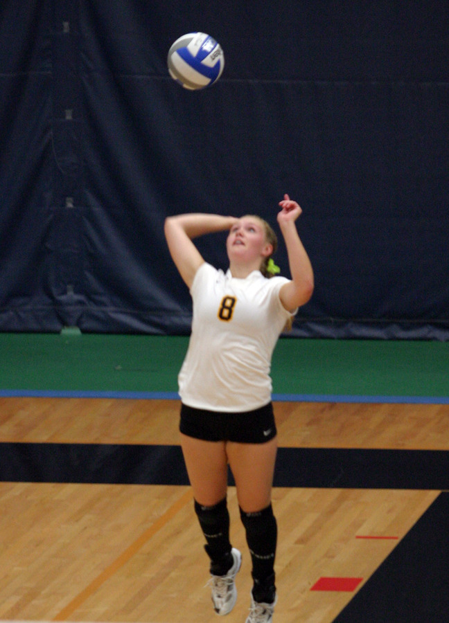 Sherman serving for Gustavus against Carleton.