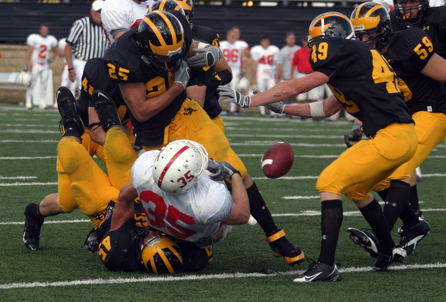 Dustin Kammerer's big hit forces a Johnnie fumble.