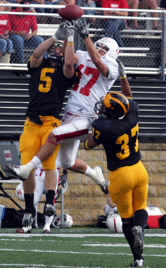 Brad Kruckeburg and Hamada Omar break up a pass intended for Sam Pederson.